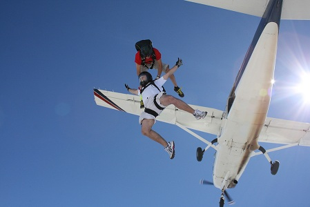 bigstock-Two-Skydivers-Exits-A-Plane-5007185