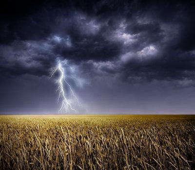 bigstock-Dark-stormy-clouds-over-a-fiel-33773636