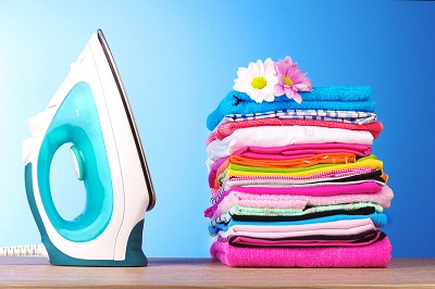 bigstock-Pile-of-colorful-clothes-and-e-17543453