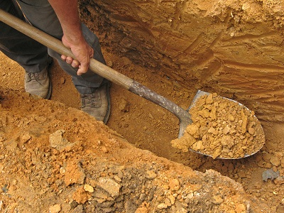 bigstock-Digging-a-trench-30407504