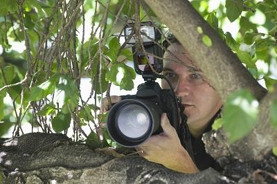 bigstock-Closeup-of-a-paparazzi-photogr-49263674