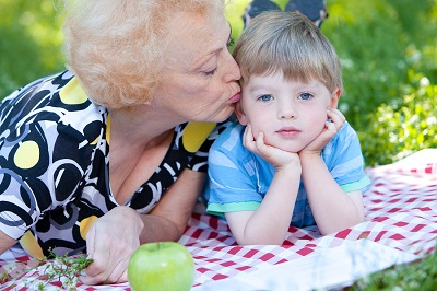bigstock-Grandmother-kissing-her-grands-35763185