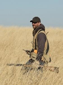 bigstock-Hunter-in-tall-grass-55799945