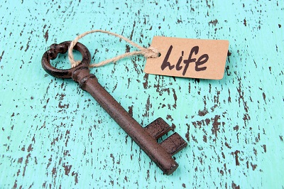 Key to life, Conceptual photo. On color wooden background