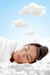 Peaceful woman sleeping on a cloud and having sweet dreams