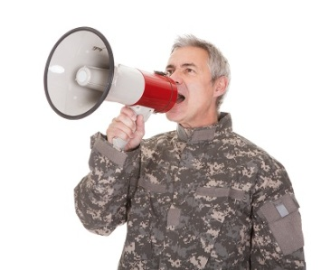 Mature Soldier Shouting Through Megaphone