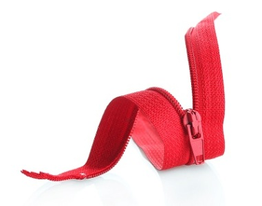Red zipper isolated on white