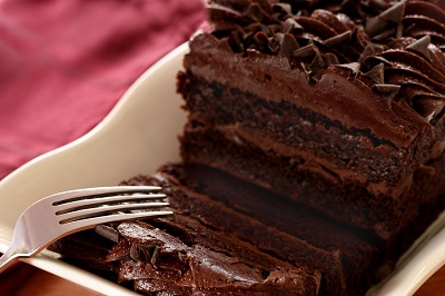 Chocolate cake with fork on a red napkin