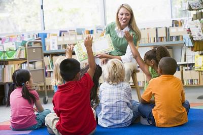 Students In Class Volunteering For Teacher