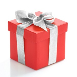 Single red gift box with silver ribbon on white background.
