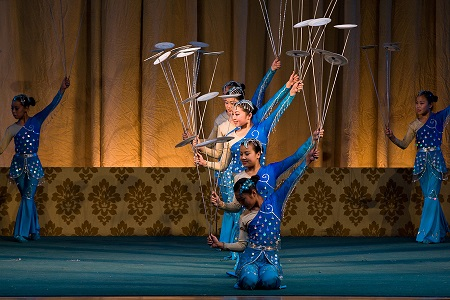 BEIJING, CHINA - JUNE 4: Balancing the spinning plates performed